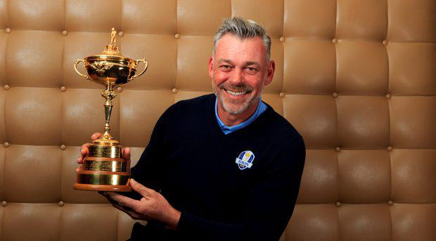 European Ryder Cup captain Darren Clarke holds the Ryder Cup trophy