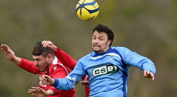 Robin Dempsey, North End Utd, in action against Keith Ryan, Moyross Utd. Aviva FAI Junior Cup, Quarter-Final, Moyross Utd v North End Utd