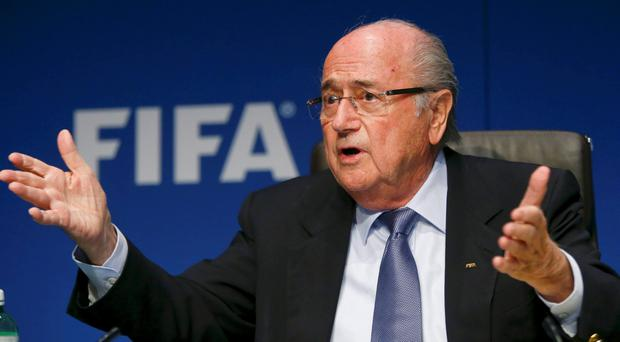 FIFA President Sepp Blatter gestures as he addresses a news conference after a meeting of the FIFA executive committee in Zurich in this March 20, 2015 file picture. Six soccer officials were arrested in Zurich on Wednesday and detained pending extradition to the United States over suspected corruption at soccer's governing body FIFA, the Swiss Federal Office of Justice said in a statement. REUTERS/Arnd Wiegmann/Files