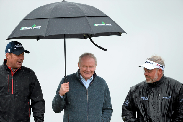 27 May 2015; Martin McGuinness, MLA, deputy First Minister of Northern Ireland Assembly, centre, along with Shane Warne, former Australian cricket player, left and Darren Clarke, walking along the fairway. Dubai Duty Free Irish Open Golf Championship 2015, Pro-Am. Royal County Down Golf Club, Co. Down. Picture credit: Oliver McVeigh / SPORTSFILE