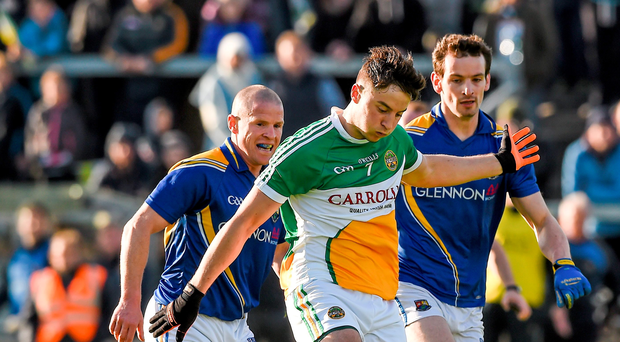 Joseph O'Connor, Offaly, in action against Dermot Brady, left, and Barry Gilleran, Longford. Leinster GAA Football Senior Championship