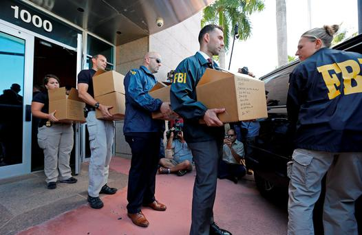 FBI agents carry boxes from the headquarters of CONCACAF after it was raided in Miami Beach, Florida. Photo: Getty Images