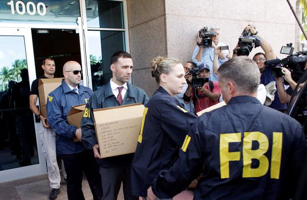 FBI agents bring out boxes after an operation inside the CONCACAF (Confederation of North, Central America and Caribbean Association Football) offices in Miami Beach, Florida May 27, 2015
