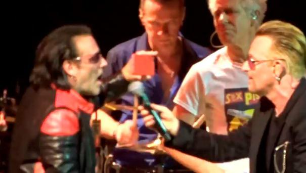 Bono performs with Bono impersonator
