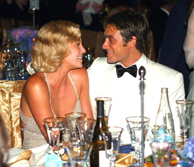 Best Actress winner Charlize Theron (L) and boyfriend Stuart Townsend enjoy the moment at the 76th Annual Academy Awards Governors Ball at the Kodak Theatre on February 29, 2004