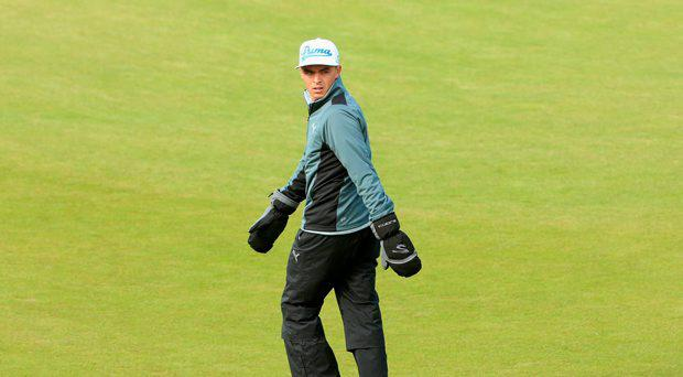 Rickie Fowler of the United States walks down the 13th hole during the First Round of the Dubai Duty Free Irish Open Hosted by the Rory Foundation at Royal County Down Golf Club on May 28, 2015 in Newcastle, Northern Ireland