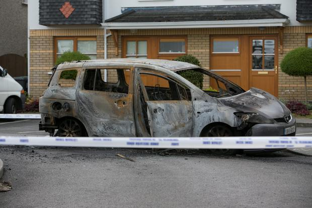 The remains of a burnt out car in Belfrey Square, Tallaght