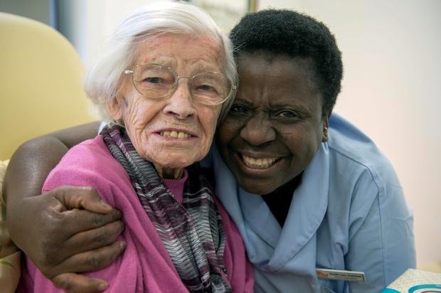 Lucy Carty celebrates her 105th birthday in Cork yest with her carer Ruth Ogebebor