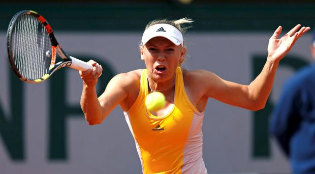 Caroline Wozniacki of Denmark plays a shot to Julia Goerges of Germany during their women's singles match at the French Open tennis tournament at Roland Garros