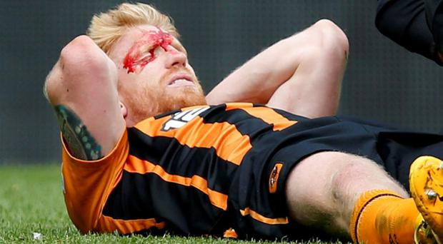 Hull City's Paul McShane lies injured after a challange by Manchester United's Marouane Fellaini resulting in a red card for Fellaini Reuters / Andrew Yates