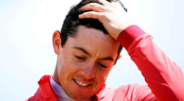 Rory McIlroy reacts as he finishes his round on 9 over par during day one of the Dubai Duty Free Irish Open at Royal County Down Golf Club