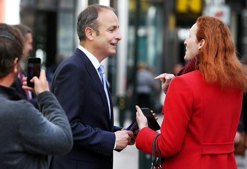 Fianna Fáil and Renua are scared to be called 'socially conservative' but they should be talking to socially conservative voters. Above, Micheal Martin canvassing on Grafton Street during the recent campaign. Photo: Steve Humphreys.