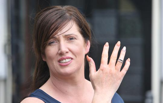 Amanda McKiernan wearing the engagement and wedding rings she found in the Hole in the Wall pub in Dublin. Picture credit: Damien Eagers
