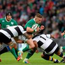 Ian Madigan, Ireland, is tackled by Ryu Koliniasi Holani, left, and Roberto Tejerizo, Barbarians. International Rugby Friendly, Ireland v Barbarians. Thomond Park, Limerick. Picture credit: Diarmuid Greene / SPORTSFILE
