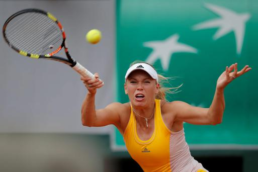 Fifth seed Caroline Wozniacki was dumped out of the French Open second round as she lost 6-4 7-6 (7/4) to Germany's Julia Goerges (AP Photo/Francois Mori)