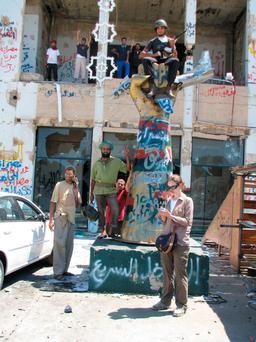 On the ground: Mary Fitzgerald at Gaddafi's compound in Tripoli after it fell to rebel forces in August, 2011