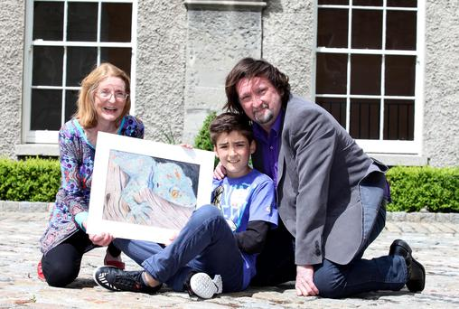 Lochlann King with his painting 'Night Shift' is pictured with his grandmother Joan King, who entered the first Texaco Art Competition 61 years ago, and his father Julian, who entered in 1976.