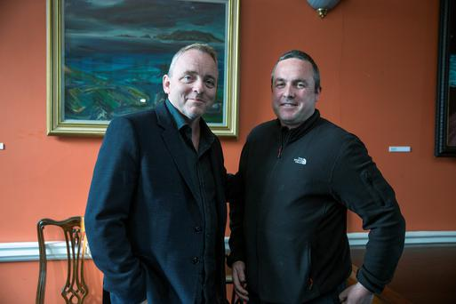 Dennis Lehane (left) with 'Love/ Hate' creator Stuart Carolan in Dublin last night