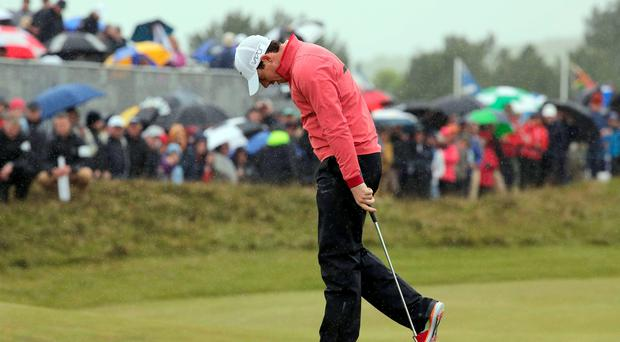 Rory misses a putt on the 18th green