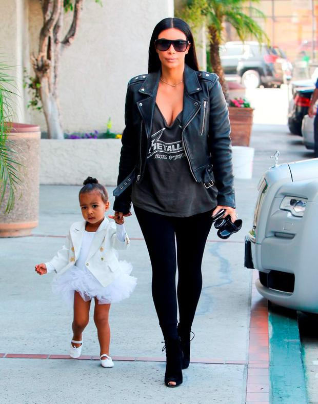 May 28: She wore a Balmain black leather jacket and v-neck t-shirt to match her daughter North 9 (two).