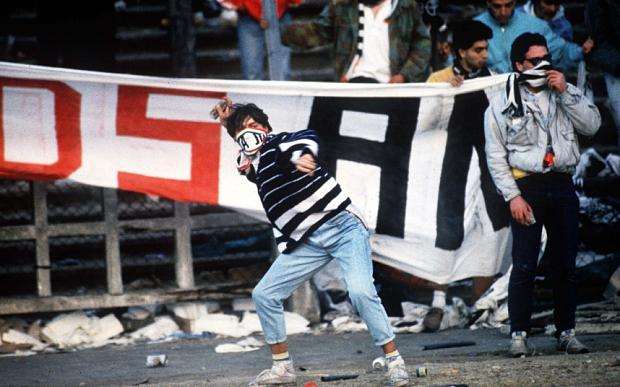 Mandatory Credit: Photo by Colorsport/REX_Shutterstock (3107996a) A Juventus Fan throws a missile Liverpool v Juventus 29/5/1985 European Cup Final 1985 Heysel Stadium 1985 Euro Cup Final: Juventus 1 Liverpool 0 Sport