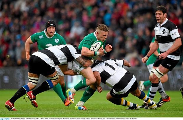 28 May 2015; Ian Madigan, Ireland, is tackled by Ryu Koliniasi Holani, left, and Roberto Tejerizo, Barbarians. International Rugby Friendly, Ireland v Barbarians. Thomond Park, Limerick. Picture credit: Diarmuid Greene / SPORTSFILE