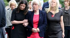 Hilary O'Herlihy, wife of Bill, pictured with her two daughters Sally and Jill as they arrive at the Church of Our Lady Foxrock for Bill O'Herlihy's funeral mass