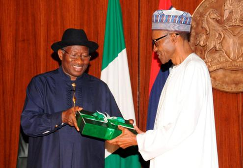 Nigeria's President Goodluck Jonathan (L) presents a gift to president-elect Muhammadu Buhari at the presidential villa in Abuja, Nigeria Credit: Afolabi Sotunde