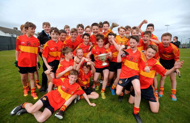 21 May 2015; St. Fintan's team celebrate with the cup. Tom Quinlan Cup Final, Ardscoil Ris v St Fintan's, Chanel (Parnells GAA), Dublin. Picture: Caroline Quinn / www.cquinnphotography.com