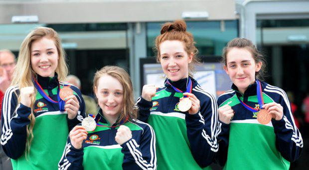 At the homecoming at Dublin Airport of Irish boxing medalists from the womens Junior and Youth World Championships in Taipei, Natasha Logan (St Brigids Edenderry), Bronze, Niamh Earley, Ryston, Newbridge, silver, Joanne Richards, St Michaels New Ross, bronze, Kelsey Leonard, Curragh BC. bronze