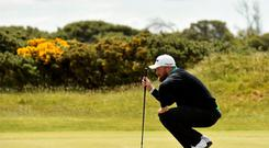 Shane Lowry, Ireland, prepares to putt on the 3rd green with his wedge. Dubai Duty Free Irish Open Golf Championship 2015, Day 2. Royal County Down Golf Club, Co. Down. Picture credit: Ramsey Cardy / SPORTSFILE