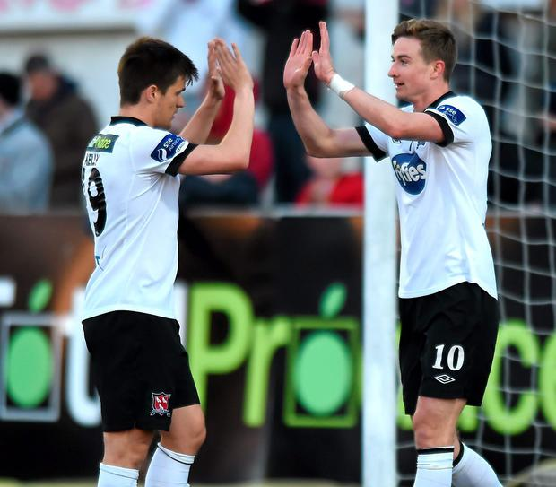 Dundalk's Ronan Finn celebrates after scoring his side's fifth goal with team-mate Jake Kelly