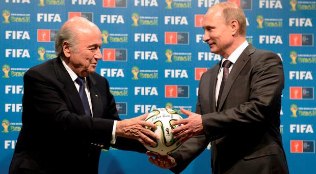 Russia's President Vladimir Putin (R) and FIFA President Sepp Blatter take part in the official handover ceremony for the 2018 World Cup scheduled to take place in Russia. Photo: Reuters