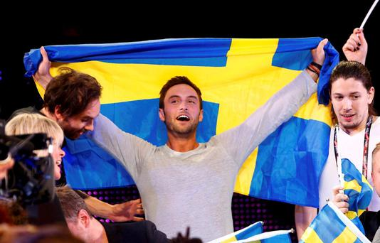 Singer Mans Zelmerloew representing Sweden celebrates winning the final of the 60th annual Eurovision Song Contest in Vienna