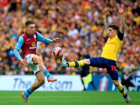 Arsenal's Hector Bellerin (right) and Aston Villa's Jack Grealish battle for the ball during the FA Cup Final at Wembley Stadium, London.