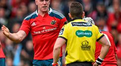 Paul O'Connell, Munster, speaks with referee Nigel Owens.
