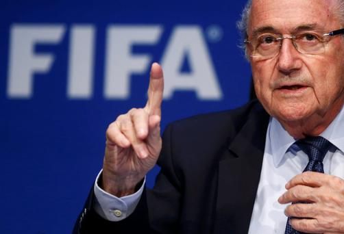 Re-elected FIFA President Sepp Blatter gestures during news conference after an extraordinary Executive Committee meeting in Zurich, Switzerland. Blatter has been re-elected as FIFA president for a fifth term after Jordan's Prince Ali bin Al Hussein conceded defeat at the Congress of world football's governing body on Friday (REUTERS/Arnd Wiegman)