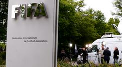 Members of the media stand in front of the entrance of the Federation Internationale de Football Association (FIFA) headquarters in Zurich, Switzerland as Sepp Blatter is re-elected as FIFA president for a fifth term (REUTERS/Arnd Wiegmann)