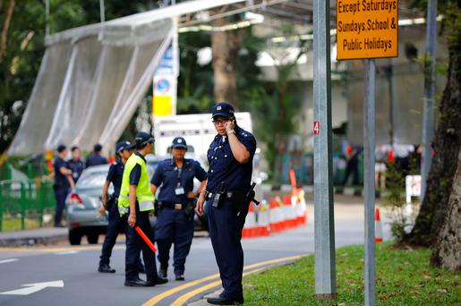 Singapore policemen man at an entry point as they stop pedestrians and attendees of the 14th International Institute for Strategic Studies Shangri-la Dialogue, or IISS, Asia Security Summit, from entering the vicinity (AP Photo/Wong Maye-E)