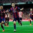 Barcelona's Lionel Messi celebrates after scoring the opening goal during the final of the Copa del Rey soccer match between FC Barcelona and Athletic Bilbao at the Camp Nou stadium in Barcelona, Spain, Saturday, May 30, 2015. (AP Photo/Manu Fernandez)