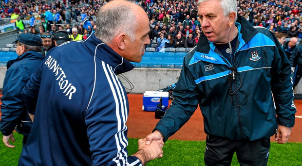 Galway manager Anthony Cunningham and his Dublin counterpart Ger Cunningham shake hands after the game.