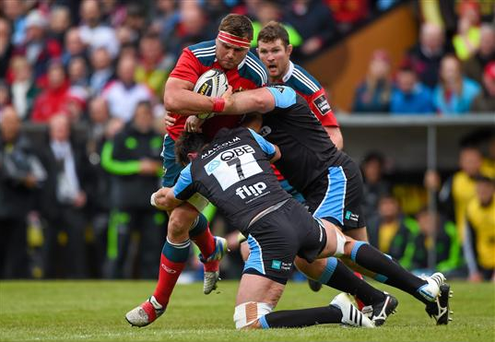 CJ Stander, Munster, is tackled by Ryan Wilson, left, and Rossouw De Klerk, Glasgow Warriors