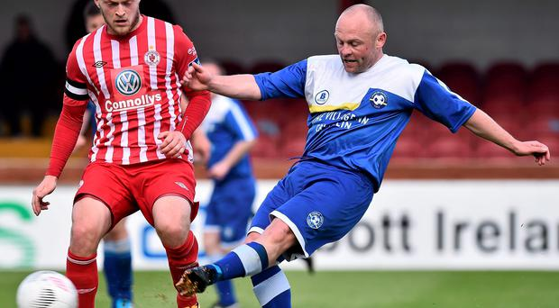 Crumlin's Martin Cramer in action against Sligo's David Cawley, Sligo Rovers