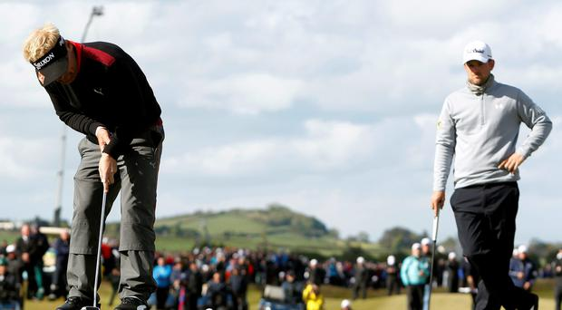 Soren Kjeldsen (left) putts to win the play off as Bernd Wiesberger looks on during day four of the Dubai Duty Free Irish Open at Royal County Down Golf Club (Brian Lawless/PA Wire)