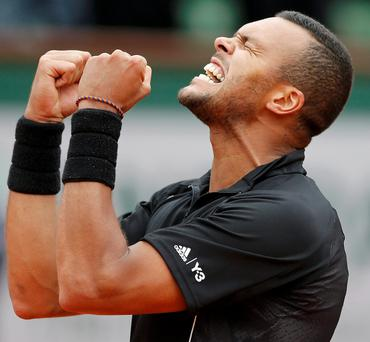 Frenchman Jo-Wilfried Tsonga celebrates after beating Tomas Berdych of the Czech Republic during their match at the French Open