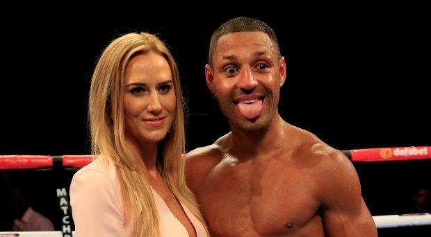 Kell Brook celebrates with his partner Lindsey Myers after defeating Frankie Gavin in their IBF World welterweight title fight at the O2 Arena, London