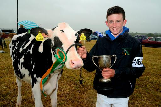 Champion: JJ O'Connor from Ballinhassig with 'Laurel Elm Stonewall', the winner of the Maiden Heifer class at the annual agricultural show at Belgooly Co Cork. Photo: Denis Boyle