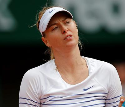 Maria Sharapova can't hide her disappointment as she makes her French Open exit at the hands of the Czech Republic's Lucie Safarova