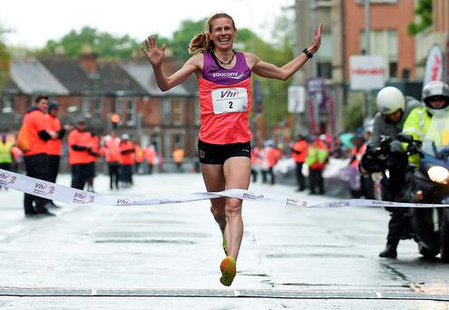 Maria McCambridge celebrates after winning the VHI Women's Mini Marathon