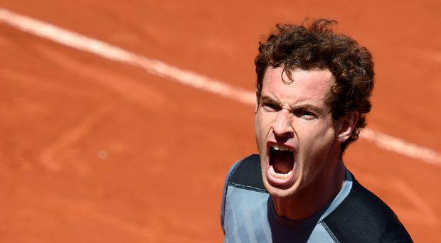Andy Murray celebrates his victory over France's Jeremy Chardy at the end of their men's fourth round match at the Roland Garros 2015 French Tennis Open in Paris on June 1, 2015